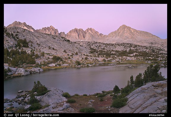 Columbine Peak and Palissades above lake at dusk, Lower Dusy basin. Kings Canyon National Park, California, USA.