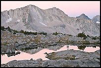 Mountains reflected in calm alpine lake at dawn, Dusy Basin. Kings Canyon National Park ( color)