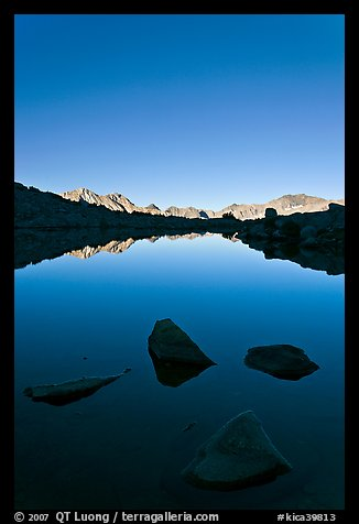 Rocks and calm lake with mountain reflections, early morning, Dusy Basin. Kings Canyon National Park (color)