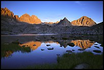Mt Thunderbolt, Isoceles Peak, and Palissades reflected in a lake in Dusy Basin, sunset. Kings Canyon National Park, California, USA. (color)