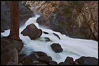 Forceful waterfall rushing through narrow granite chute. Kings Canyon National Park, California, USA.