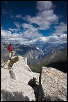 Hiker taking in view from Lookout Peak. Kings Canyon National Park, California, USA.