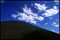 Smooth cinder cone profile and clouds. Lassen Volcanic National Park, California, USA. (color)