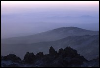 Ridges and volcanic rocks from  summit of Lassen Peak, sunset. Lassen Volcanic National Park, California, USA.