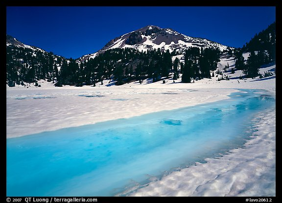 Turquoise melting snow in lake Helen and Lassen Peak, late spring. Lassen Volcanic National Park (color)