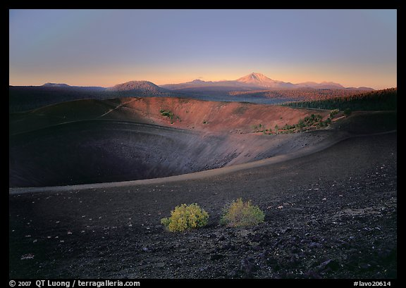 Sagebrush bushes, Cinder cone rim, and Lassen Peak, sunrise. Lassen Volcanic National Park, California, USA.