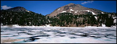 Melting ice in lake and Lassen Peak. Lassen Volcanic National Park, California, USA.