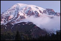 Mount Rainier and fog at dawn. Mount Rainier National Park, Washington, USA.