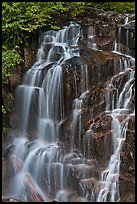 Water cascading over columns of volcanic rock. Mount Rainier National Park, Washington, USA. (color)