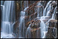 Waterfall over columns of cooled lava. Mount Rainier National Park, Washington, USA. (color)