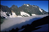 Sun projected on fog below peaks, early morning, Cascade Pass area, North Cascades National Park.  ( color)