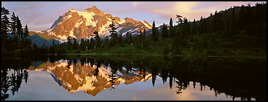 Mount Shuksan reflected in lake at sunset. North Cascades National Park (Panoramic color)