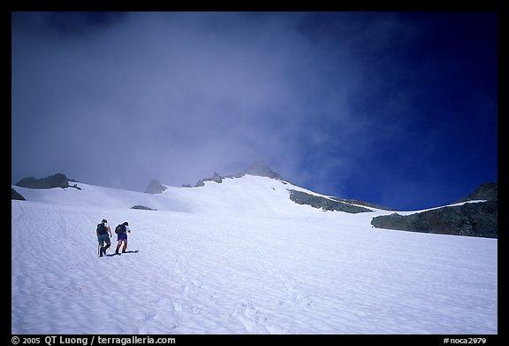 Mountaineers climbing a snow field on Sahale Peak,  North Cascades National Park.  (color)