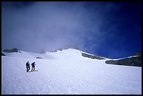 Mountaineers climbing a snow field on Sahale Peak,  North Cascades National Park. Washington, USA. (color)