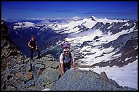 Mountaineers on ridge below  summit of Sahale Peak, North Cascades National Park. Washington, USA.