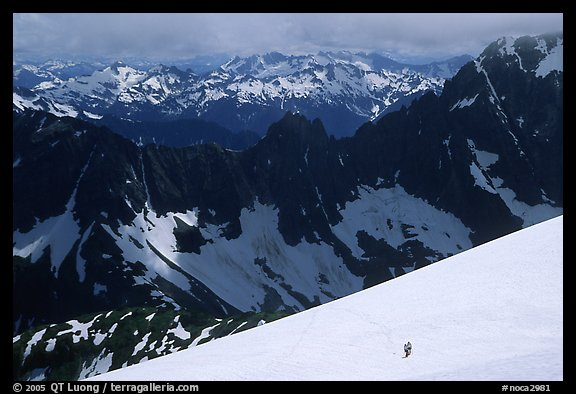 Mountain ridges, and mountaineers on snow field, North Cascades National Park.  (color)