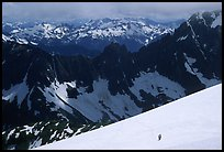 Mountain ridges, and mountaineers on snow field, North Cascades National Park. Washington, USA. (color)