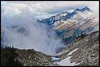Mountains and clouds above South Fork of Cascade River, North Cascades National Park. Washington, USA.