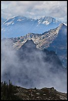 Peaks partly obscured by clouds, North Cascades National Park. Washington, USA.