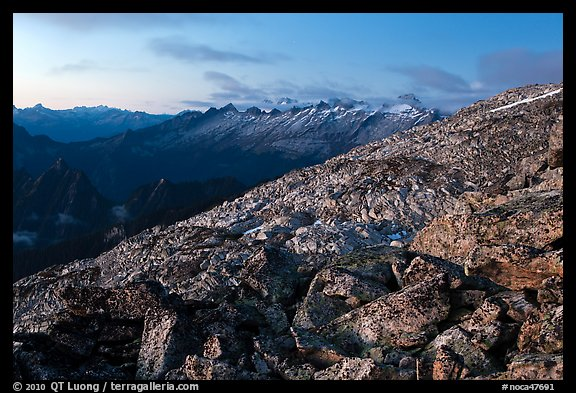 Rocky slope and distant range at dusk, North Cascades National Park.  (color)