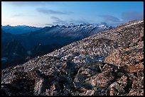 Rocky slope and distant range at dusk, North Cascades National Park. Washington, USA.