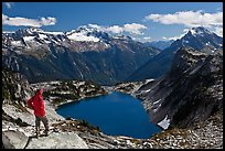 Hiker stands above Hidden Lake, North Cascades National Park. Washington, USA.
