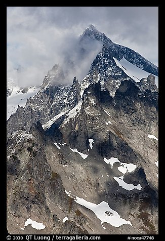 Cloud-shrouded Eldorado Peak, North Cascades National Park.  (color)