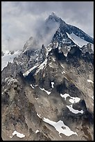 Cloud-shrouded Eldorado Peak, North Cascades National Park. Washington, USA.