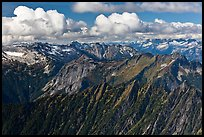 Mountains and afternoon cumulus clouds, North Cascades National Park. Washington, USA.