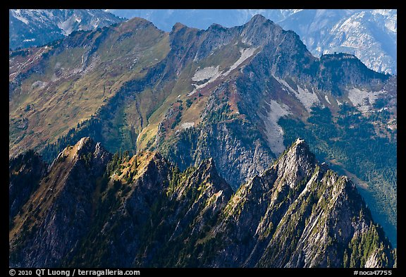 Steep forested spires in dabbled light, North Cascades National Park.  (color)