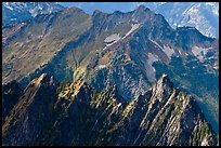 Steep forested spires in dabbled light, North Cascades National Park. Washington, USA.