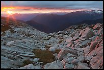 Last rays of sunset color rocks in alpine basin, North Cascades National Park. Washington, USA.