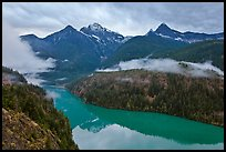 Colonial Peak and Pyramid Peak above Diablo Lake on rainy evening, North Cascades National Park Service Complex. Washington, USA.