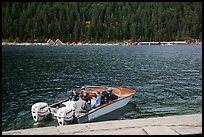 Boat ride across lake to Ross Lake resort, North Cascades National Park Service Complex.  ( color)