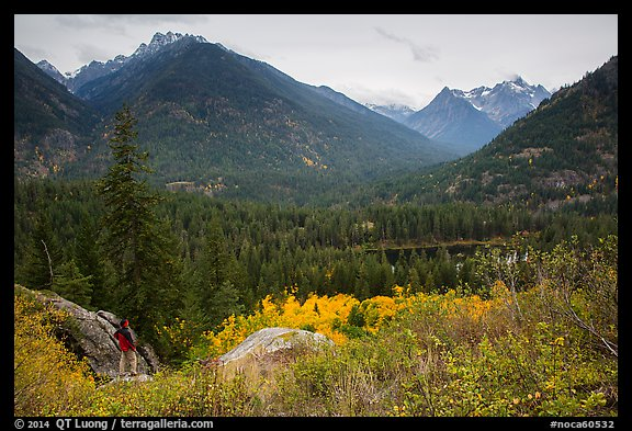 Visitor looking, McGregor Mountain above Coon Lake, North Cascades National Park Service Complex.  (color)