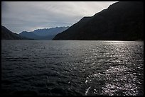Sun shimmering in Lake Chelan waters, North Cascades National Park Service Complex.  ( color)