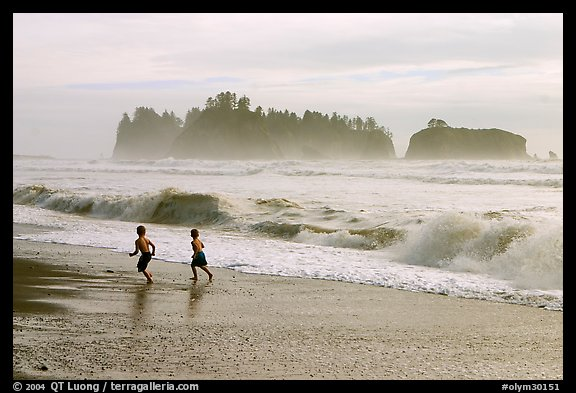 Children running along surf, Rialto Beach. Olympic National Park (color)
