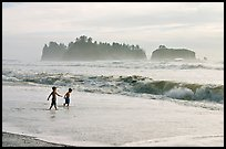 Children playing in water in front of sea stacks, Rialto Beach. Olympic National Park ( color)