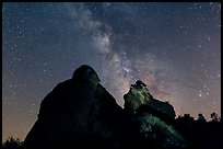 Night sky with Milky Way above High Peaks rocks. Pinnacles National Park, California, USA. (color)