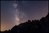Rocky ridge and star-filled sky with Milky Way. Pinnacles National Park, California, USA. (color)