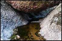 Creek flowing under boulder. Pinnacles National Park, California, USA. (color)