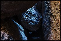 Dark passage with wedged boulder, Balconies Cave. Pinnacles National Park, California, USA. (color)