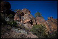 Looking up rock towers and starry night sky. Pinnacles National Park ( color)