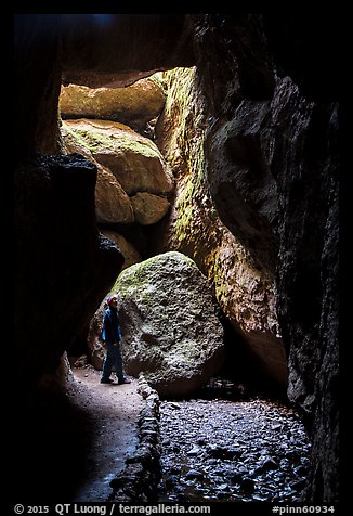Hiker looking around Bear Gulch Cave. Pinnacles National Park (color)