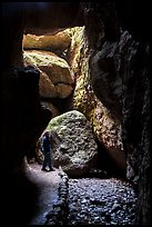 Hiker looking around Bear Gulch Cave. Pinnacles National Park ( color)