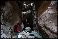Hiker looking from staircase down into Lower Bear Gulch Cave. Pinnacles National Park ( color)