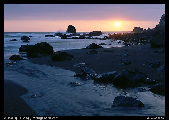 Stream and beach at sunset, False Klamath Cove. Redwood National Park, California, USA.