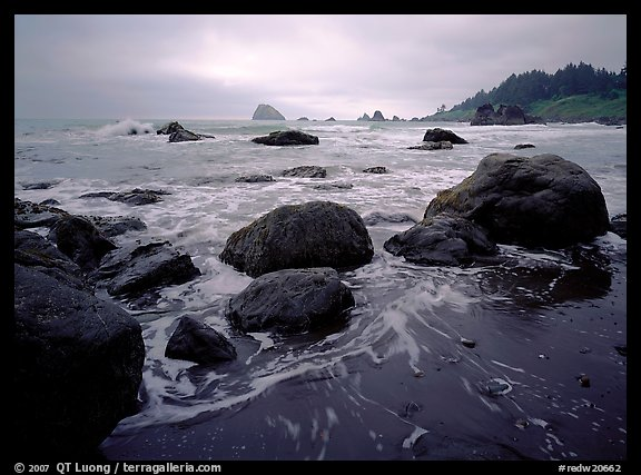 Sand, boulders and surf, Hidden Beach. Redwood National Park, California, USA.