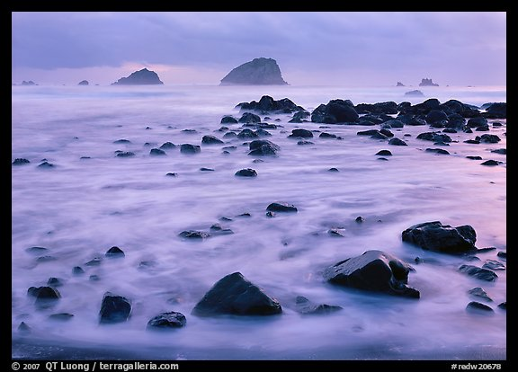 Wave motion over rocks in  purple light of dusk. Redwood National Park, California, USA.