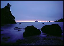 Rocks and seastacks, cloudy sunset, Hidden Beach. Redwood National Park, California, USA.